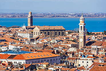 Venice Italy rooftops panoramic day city north view with low rise buildings with red tiles, seen from Saint Marks Campanile.