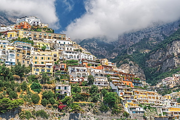 View from sea of low-rise buildings and cliffs along the coastline, Positano, Costiera Amalfitana (Amalfi Coast), UNESCO World Heritage Site, Campania, Italy, Europe