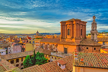 Rooftops landscape panorama with low-rise buildings and  Basilica di Sant'Andrea delle Fratte at golden hour elevated view, Rome, Lazio, Italy, Europe