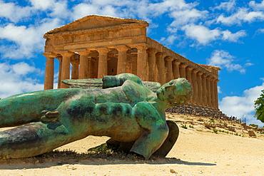 Temple of Concordia with statue, ancient Greek Doric temple with Fallen Icarus bronze statue in Valley of the Temples, Agrigento, UNESCO World Heritage Site, Sicily, Italy, Europe