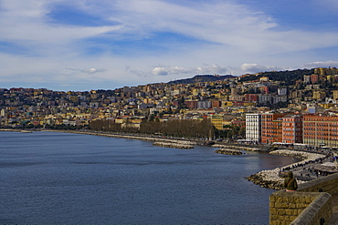 Promenade and city view, Villa Comunale park at the waterfront seen from Castel dell Ovo fortress at Napoli Gulf, Naples, Campania, Italy, Europe