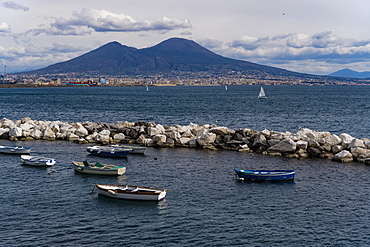 Day view of Mount Vesuvius, the active volcano, seen from the Gulf of Napoli with buildings ashore, Naples, Campania, Italy, Europe