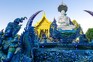 Fountain and front entrance of Wat Rong Suea Ten (Blue Temple) in Chiang Rai, Thailand, Southeast Asia, Asia