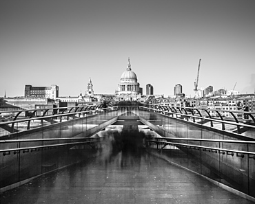 Ghostly figures going to work in long exposure image of St. Paul's from Millennium Bridge, City of London, London, England, United Kingdom, Europe