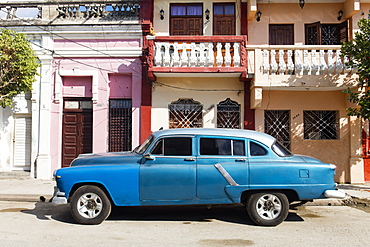 Old blue American car parked in front of old buildings, Cienfuegos, UNESCO World Heritage Site, Cuba, West Indies, Caribbean, Central America
