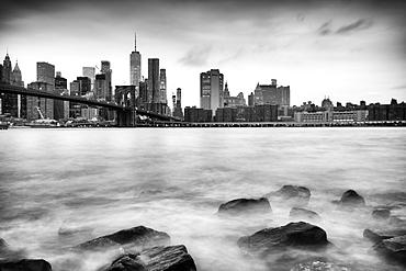 Brooklyn Bridge and Lower Manhattan skyline taken from Pebble Beach, New York City, New York, United States of America, North America