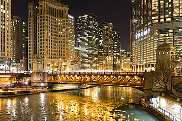 Trump Tower and frozen Chicago River at night, Chicago, Illinois, United States of America, North America