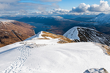 Looking down to Loch Cluanie from the summit of Sgurr an Fhuarail above Glen Shiel in Kintail, Highlands, Scotland, United Kingdom, Europe