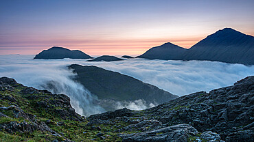 Sunrise behind Bla Bheinn and Marsco with an early morning inversion filling Glen Sligachan and flowing over the minor tops