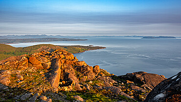 Looking down on the village of Elgol and the Isle of Eigg from the summit of Sgurr na Stri on Skye at sunset