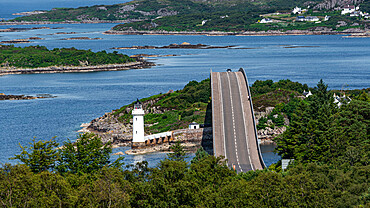 The Skye Bridge over Loch Alsh, connecting the Isle of Skye to Eilean Bàn and the mainland. Kyleakin Lighthouse on the island