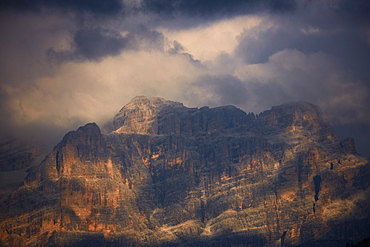Sella mountain range in the Dolomite alps seen from Groedner pass in evening light, South Tyrol, Italy, Europe