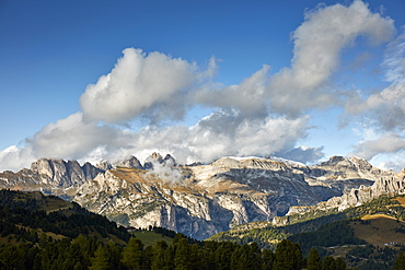 Sella and Geisler mountain range in the Dolomite alps seen from Groedner pass in early fall, South Tyrol, Italy, Europe