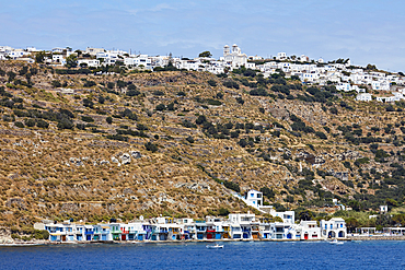 Famous Klima village with its colorful boat houses and Plaza above on Milos island