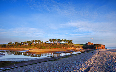 Warm afternoon sun at mouth of the River Otter at Budliegh Salterton, Devon, UK