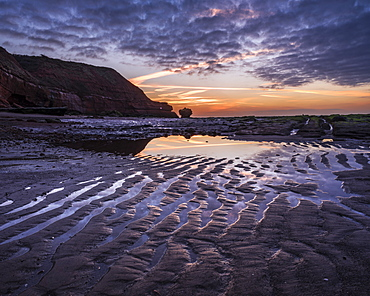 Sand ripples at dawn on the beach at Orcombe Point, Exmouth, Devon, England, United Kingdom, Europe