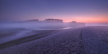 Winter twilight and heavy band of mist from River Otter at Budleigh Salterton, Devon, England, United Kingdom, Europe