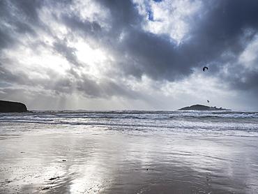 A kitesurfer off the beach at Bantham during a storm, near Kingsbridge, Devon, England, United Kingdom, Europe