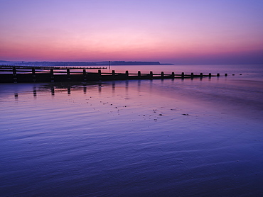 Early morning looking at Exmouth beyond the sea defences, Dawlish Warren, Devon, England, United Kingdom, Europe