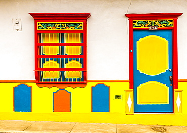 A view of a typical colourful preserved colonial building, Jardin, Colombia, South America