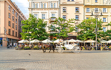 Horse and carrriage taxi in The Old town Square, UNESCO World Heritage Site, Krakow, Poland, Europe