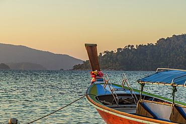 A long tail boat at dusk in Ko Lipe, Tarutao National Marine Park, Thailand, Southeast Asia, Asia