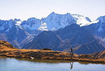 Mountain trekker in autumn season in Stelvio National Park in Brescia Province, Lombard, Italy, Europe