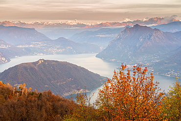 Iseo Lake, Monte Isola and Orobie Alps at sunset with fog in autumn season, Brescia Province, Lombardy, Italy, Europe