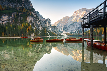 Lake of Braies in autumn with the typical boats of the place, Bolzano Province, Trentino-Alto Adige, Italy, Europe