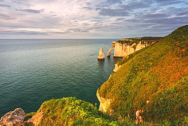 Les Falaises (cliffs) of Etretat at sunset, Etretat, Normandy, France, Europe