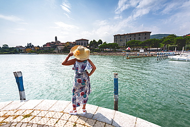 Woman admiring Clusane d'Iseo, Lake Iseo, Brescia province, Lombardy, Italy, Europe