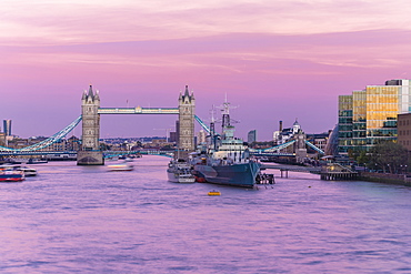 Tower Bridge with HMS Belfast at sunset with purple sky above the River Thames, London, England, United Kingdom, Europe