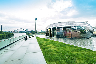 Gehry Buildings and Media Hafen with the TV tower of Dusseldorf in the background, Dusseldorf, North Rhine-Westphalia, Germany, Europe