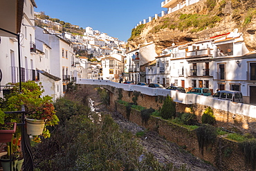 Setenil de las Bodegas with its white historic buildings and the houses under the rock mountain, Setenil de las Bodegas, Province of Cadiz, Spain, Europe