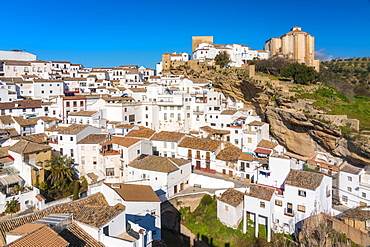 Overview of The Setenil de las Bodegas, with its white historic buildings and the houses under the rock mountain, Setenil de las Bodegas, Province of Cadiz, Spain, Europe