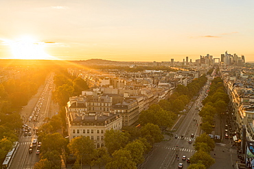 View from Arc de Triomphe at sunset, with La Defense in the distance on the right, Paris, France, Europe