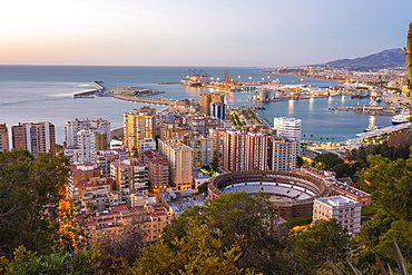 View from the view point of Gibralfaro by the castle with the La Malagueta bullring and the harbor at sunrise, Malaga, Andalusia, Spain, Europe