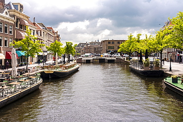 Nieuwe Rijn (New Rhine) canal with Karnemelksbrug bridge, cafes and shops in the heart of Leiden, South Holland, The Netherlands, Europe