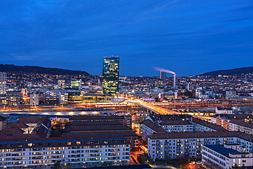 View of Zurich district 4 and 5 and Prime Tower, Hard Bridge from above at night, Zurich, Switzerland, Europe
