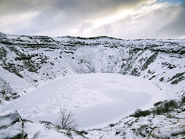 Kerid Crater, a frozen lake occupying a Volcano, Iceland, Polar Regions