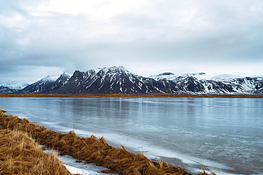 View of the mountains of Snaefellsnes at the peninsula early in the morning with water freezing in the foreground, Iceland, Polar Regions