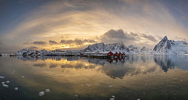 Panoramic winter landscape with snowcapped mountains and snow covered village of Hamnoy, Lofoten Islands, Arctic, Norway, Europe