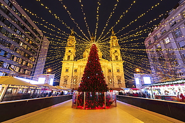 Christmas tree at night in front of St. Stephen's Basilica in Budapest, Hungary, Europe
