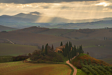 Podere Belvedere and Tuscan countryside with dramatic sky, San Quirico d'Orcia, Tuscany, Italy, Europe