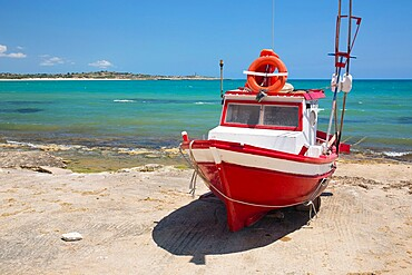 Colourful fishing boat on slipway, the turquoise waters of the Mediterranean Sea beyond, Sampieri, Ragusa, Sicily, Italy, Europe
