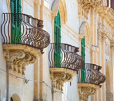 Typical wrought iron balconies on the baroque Palazzo Astuto di Fargione, Noto, UNESCO World Heritage Site, Syracuse (Siracusa), Sicily, Italy, Europe