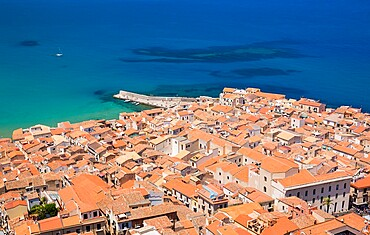 View over the colourful tiled rooftops of the Old Town from La Rocca, Cefalu, Palermo, Sicily, Italy