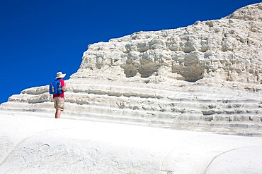 Visitor admiring the white limestone cliffs of the Scala dei Turchi, Realmonte, Porto Empedocle, Agrigento, Sicily, Italy, Mediterranean, Europe