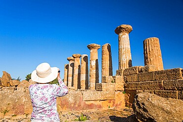 Visitor photographing the Temple of Heracles (Temple of Hercules), UNESCO World Heritage Site, Valley of the Temples, Agrigento, Sicily, Italy, Mediterranean, Europe