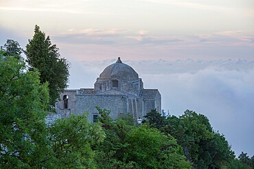 The hilltop Church of San Giovanni Battista, low cloud obscuring the landscape beyond, Erice, Trapani, Sicily, Italy, Mediterranean, Europe